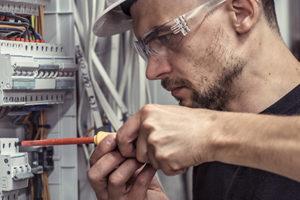 Electrician repairing a transformer