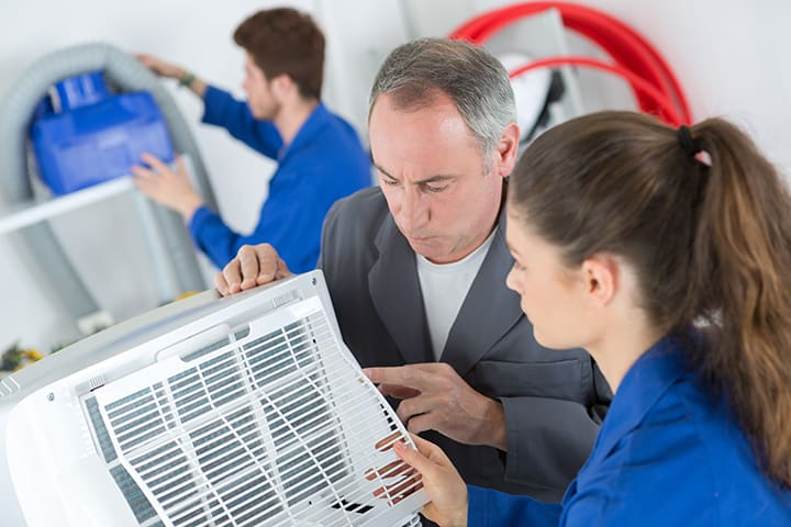 Student technicians learning about HVAC Maintenance