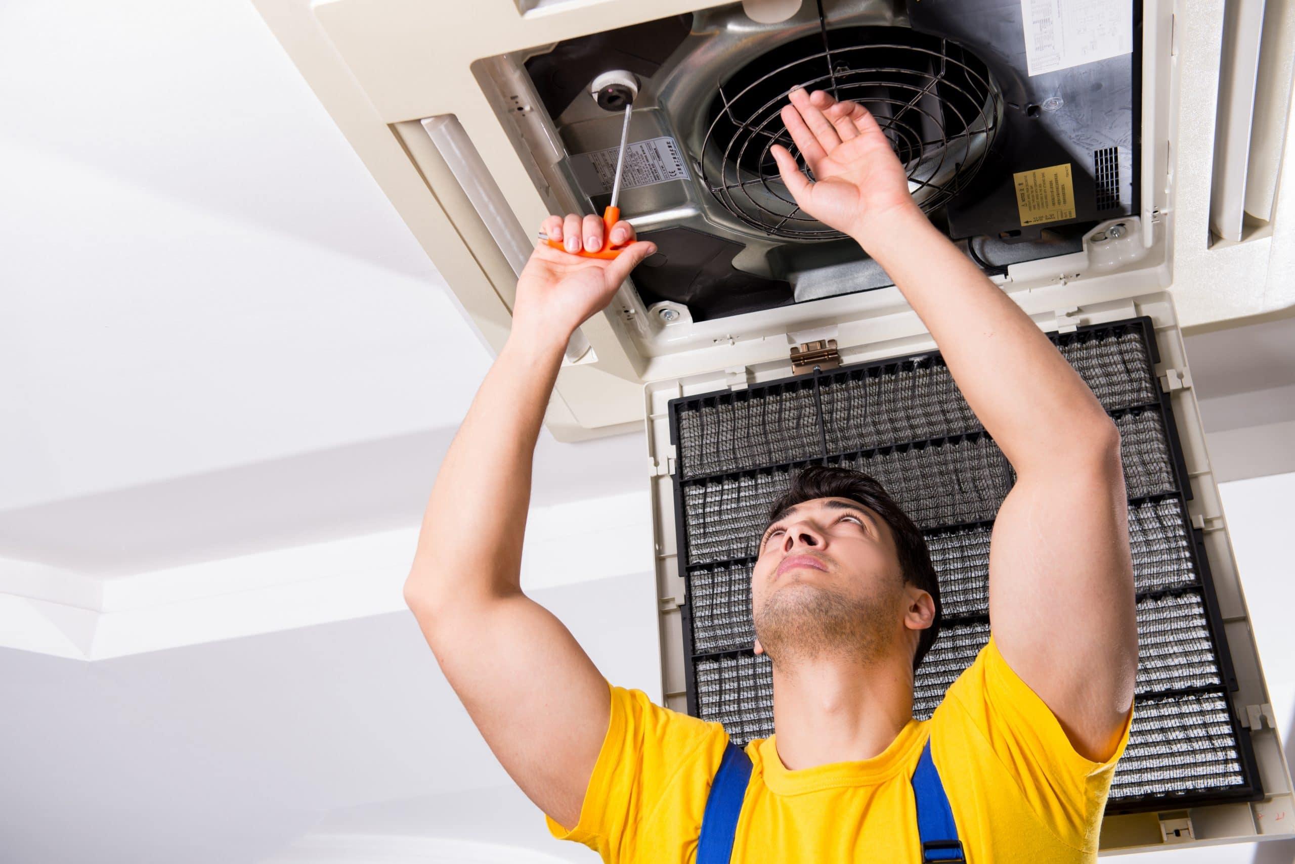 hvac technician fixing an AC